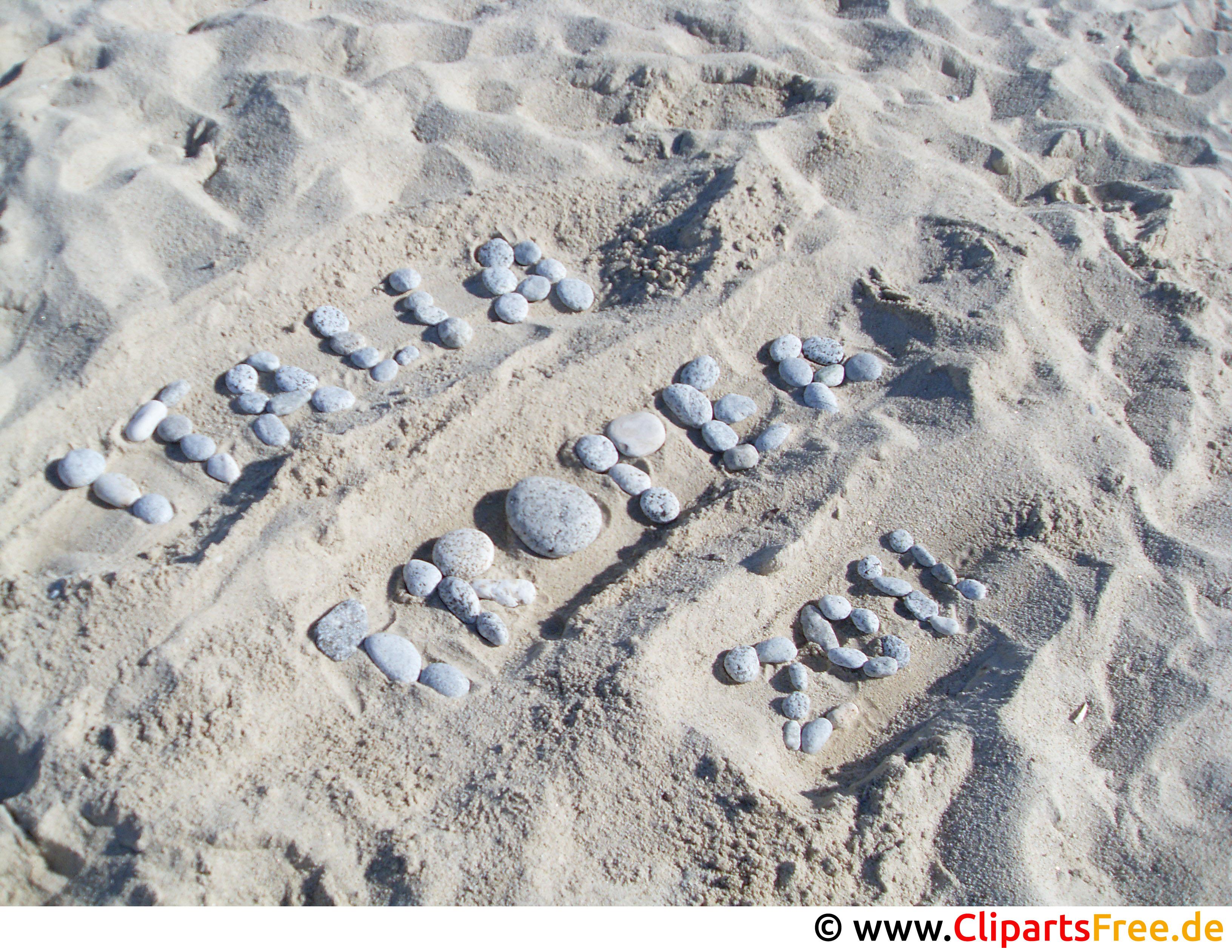 Buchstaben auf dem Sand im Urlaub Foto