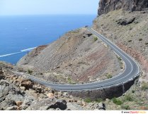 Car road in the mountains at the edge of the sea Photo, image for free