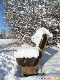 Bænk under sneen Foto gratis