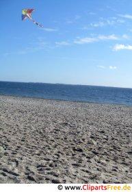 Drachen steigenlassen am Strand Foto kostenlos