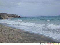 Vågor på strandfotoet