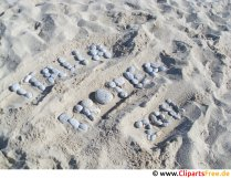 Bogstaver på sandet på feriefoto